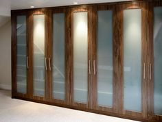 built-in wardrobes timber finish with opaque glass