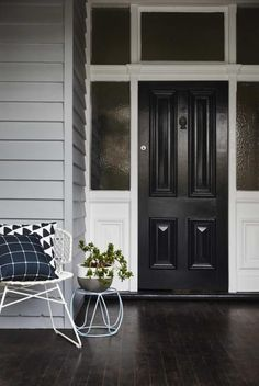 """Black doors almost ground the home; they act as a focal point, drawing your attention. They are bold, and pack a powerful punch. If black isn't your preference, then maybe try bringing a bold colour in. Exterior Color Schemes, Exterior House Colors, Exterior Design, Interior And Exterior, Colour Schemes, Modern Exterior, Mesa Exterior, Exterior Doors, Stucco Exterior"