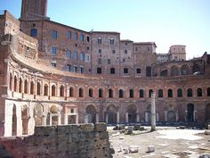 Trajan's Market, Imperial Forum, Rome. a single monumental facade was built, consisting of a large, semicircular exedra, preceded by a colonnade - it was used for warehouses for foodstuffs and as a retail sales area. It is thought that wings to this building may have housed auditoriums or lecture halls.