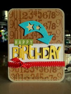 This great arrow is the focus on this handmade birthday card using chipboard stickers and embossing glitter.