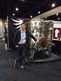 Stanislas Padzunass from @La Garde Inox wine tanks at the #Wine Expo with an elegant La Garde #WineTank. Discover more #StainlessSteel cubic #WineTanks at  http://www.lagardeinox.com/en/products