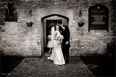 bride and groom kiss outside of the church