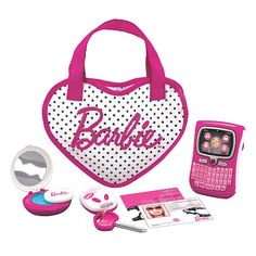 Cell phone, keys, compact and I.D., everything a doll needs to pack her purse just like mom.
