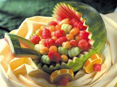 Brimming with fresh fruit, expecting moms will adore seeing this lovely centerpiece at their baby shower.    How to carve the Baby Carriage watermelon.