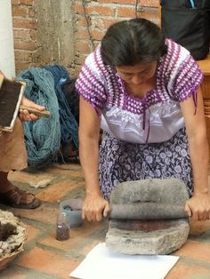 and that's how we do it in Oaxaca. Grinding peppers to make Mole