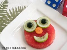 ELMO VEGGIE SNACK:  Use sliced tomato, cucumber, carrot, and olives to entice your Sesame Street crazed picky eater to try veggies