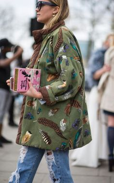 feathered jacket and a bag with personality