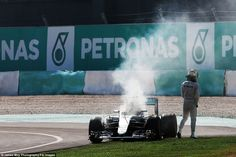Lewis Hamilton suffered a dramatic engine failure on lap 41 at the Malaysian Grand Prix in...