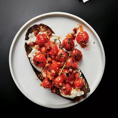 Burst Cherry Tomatoes and Pancetta   Burst Cherry Tomatoes and Pancetta from Best New Chef Michael Gallina of Vicia in St. Louis begs to be served over ricotta toast. Get the recipe at Food & Wine.