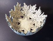 White stoneware maple leaf bowl with green mishima glazing.  Private Collection