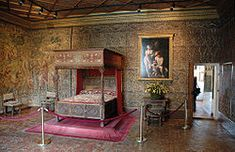 Catherine de Medici's bedroom, Chenonceau  Renaissance chimney and floor tiles    Bedroom of Catherine de Medici.  This bedroom contains 16th-century sculpted furniture and is decorated with a series of 16th-century Flemish tapestries retracing Samson's life.
