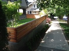 Concrete Retaining Wall w/ Modern Wood Trellis