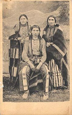 """Souwangesheick and His Squaws, Cree Indians."""