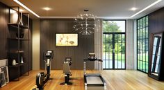 {fitness room} with clean-lined shelves and airy light fixture. {fitness room} with clean-lined shelves and airy light fixture. Dream Home Gym, Gym Room At Home, Home Gym Decor, Home Gym Design, House Design, Small Home Gyms, Gym Lighting, Gym Interior, Beauty Salon Interior