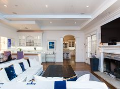 Despite the adjacent kitchen, Jessica Alba's main living space features a built-in bar for entertaining guests.