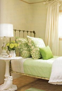 Guest room ideas.  Love the crystal lamp with the metal bed.