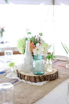 mason jars on wood slices wedding