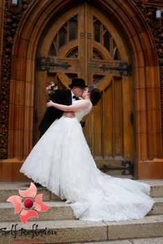 Dip on the church steps... yes please =) Classic wedding shot