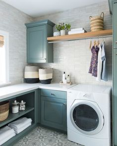 A new classic laundry room remodel with clay tiles, green cabinets, and patterned tile flooring | Studio McGee Blog