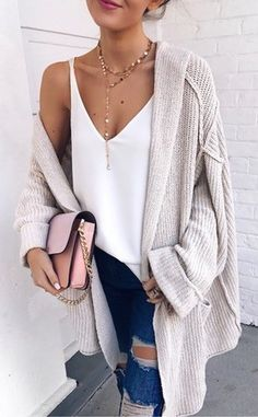 #fall #outfits  girl's white plunging neckline top with cream cardigan and blue ripped jeans