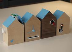 FLOCK cuckoo clock  by BERG for TWITTER - The birds inside this cuckoo clock by London design studio BERG are programmed to poke their heads out to announce Twitter messages, retweets and new followers