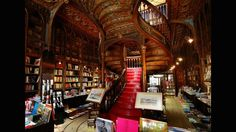 Livraria Lello, Porto -- This Portuguese landmark opened in the former Chardron Library at the turn of the 19th Century. Its Art Nouveau space is dominated by a curving staircase with ornate wooden carvings to match its intricate wall panels and columns.