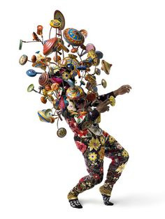 Sculpture by Nick Cave. Soundsuit, 2009. Found, vintage, and knit material with hot pads, beaded appliques, metal armature, noisemakers, and found metal toys.