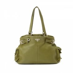 The authenticity of this vintage Prada shoulder bag is guaranteed by  LXRandCo. 98c78211567fa