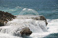 Waves splashing on a rocky shore