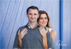 Jessica & Brett's Engagement Photography Session - Santa Monica Pier - Los Angeles, CA - boardwalk, ferris wheel, carnival, ride, games, beach, formal, dress, suit, couple, engaged, sunset, blue wall, silhouette, GilmoreStudios.com
