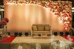 floral wall , curtains , white and peach decor , indoor banquet decor , stage decor
