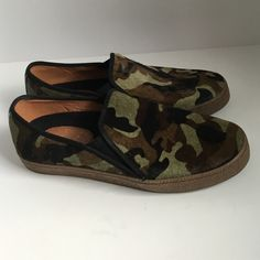 Calf hair camo slip on sneakers Totally on trend, the calf hair camo slip on sneakers are amazing!  The green, brown and black print goes with everything's.  Pair with jeans or a summer dress.  Rubber soles.  Never warn - perfect confirm!  Size 10m. Corso Como Shoes Sneakers