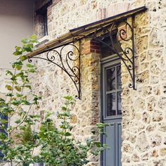 such beautiful metal ironwork on this vintage door canopy- so lovely against the old stonework French Country House, French Farmhouse, Door Design, House Design, French Doors, Windows And Doors, Pergola, Outside Room, Iron Work