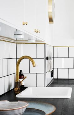 White tiles, grey floors and brass accents - via Coco Lapine Design