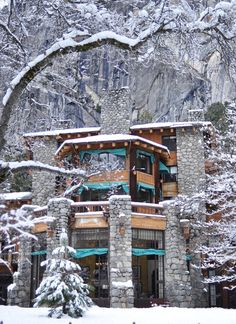 the famous Ahwahnee Hotel at the base of a granite cliff in Yosemite National Park – visually stunning anytime of year, but breathtaking in winter