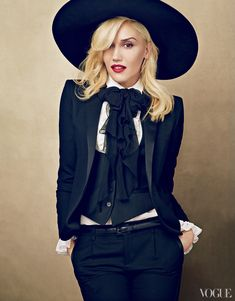 """Gwen Stefani """"What sets Gwen apart for sure from the Katy Perrys, the Taylor Swifts, is that she fronts a rock band,"""" says No Doubt member Tom Dumont. Saint Laurent by Hedi Slimane silk blazer, scarf, blouse with ruffle detail, wool vest, trousers, and felt hat."""