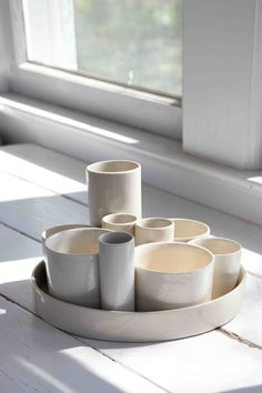 10 vessels - stealing this for my mixed tea cups and silver wooden tray