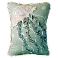 Cotton throw pillow with a jellyfish motif.