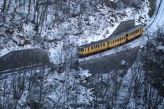 Journey through the French Pyrenees on Le Train Jaune (AKA The Canary). Image by Raymond Roig/Photostock Getty.