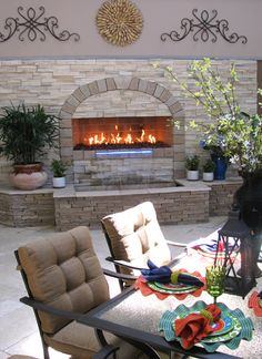 An Isokern fireplace by earthcore® with a water feature on both ...