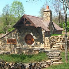 "I wasn't sure where to put this one.  I love the quaint rock cottage style of this home, and the Hobbit door is fantastic but not something I would want for my ""every day"" house.  But, I thought it deserved some recognition!"