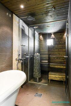 Tummasävyisen saunan ja kylpyhuoneen välinen lasiseinä tuo tilantuntua saunaosastoon. Modern Saunas, Sauna Room, Infrared Sauna, Scandinavian Home, Bath Design, Master Bathroom, Tiny House, Bathtub, Rustic