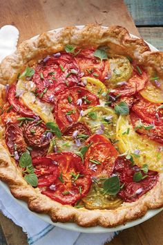 A tomato pie is a delicious creation--almost as good as the first tomato sandwich of the season. Every summer, I look forward to it. If you've never heard of a tomato pie, think of it as an eggless quiche. Trust me, it will become your new favorite. Fresh Tomato Recipes, Herb Recipes, Pie Recipes, Vegetable Recipes, Cooking Recipes, Quiche Recipes, Veggie Dishes, Recipes Dinner, Corn Pie