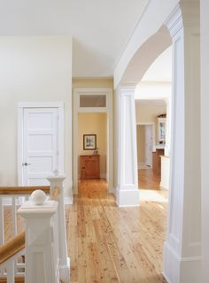 Beautiful white Craftsman pillars and lovely natural wood floors - plan 051S-0054 - houseplansandmore.com