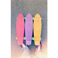 cool skateboards ... pink(?), violet & yellow skateboards... Pennies! ♥