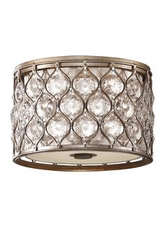 This flush mount light from the Lucia collection by Feiss is ideal for limited ceiling height or when you'd like an obstructed view. With a low profile, Burnished Silver finish, and unique Sunflower Shape Bauhinia crystals, it will add a glamorous touch to your entryway, hallway, bedroom or living room.
