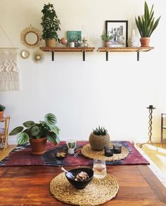 Stellar spaces...a lovely boho dining table set up! Love the floating shelves with plants and hanging macrame too!