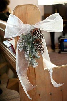 Pinecone and fir wedding aisle decor   An Enchanting Winter Wedding in Ste-Adele, Quebec   Weddingbells