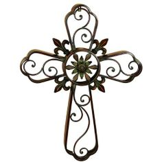 Hanging Wall Cross Fleur-De-Lis Metal Wall Decor Sculpture by ecWorld. $69.99. Weight: 3.6. Ready to hang with keyhole on the back of the product. Colors: Copper and dark brown. Materials: Metal. Dimensions: 32 in H x 2.5 in W x 23.5 in L. The Wall Cross Metal Sculpture is the perfect accent to add a traditional element with a contemporary flair to any decor. Depicts the perfect size cross with fleur-de-lis accents, intricate scrollwork and a center medallion to add to the aesth...