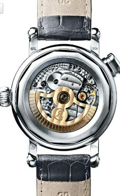 """Chronoswiss Ouroboros for ONLY WATCH 2015 - The insides of the timepiece, which are visible through the transparent case back, are also fascinating. The automatic movement Chronoswiss Caliber C.126, offering a 40-hour power reserve and beating at 21.600 A/h, powers a quarter repeater mechanism. A small hammer strikes its gong to ring out the number of hours (""""ding""""), then two small hammers strike against two meticulously tuned gongs to ring out the number of quarter-hours (""""ding-dong""""). The…"""